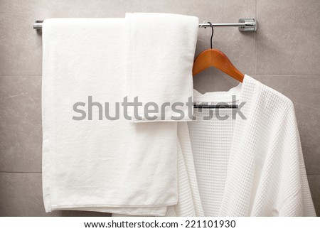 towel and robe on the rack in the bathroom - stock photo