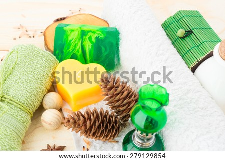 towel, candle and handmade soap on wooden - stock photo