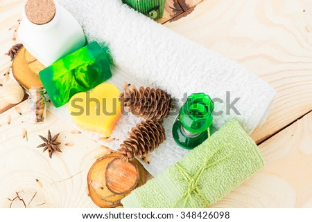 towel, candle and handmade soap on wooden