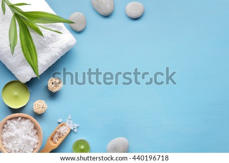 Towel,candle,salt and stone on blue background - stock photo
