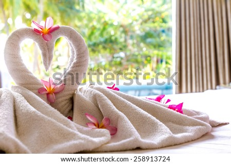 towel decoration in hotel room, towel birds, swans, room interior - stock photo