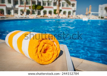 towel on a background of pool. - stock photo