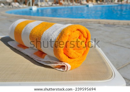towel on a lounger, summer vacation. - stock photo