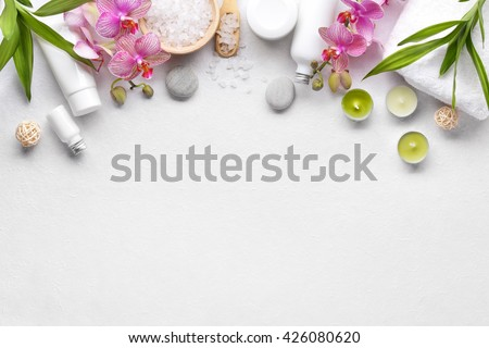 Towel,orchid flowers,bamboo leaf and cosmetics - stock photo