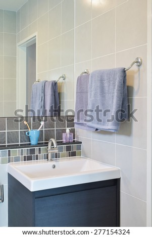Towel rail next to Lavatory with toothpastes  in modern decorative - stock photo