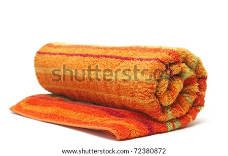 towel rolled up on a white background - stock photo