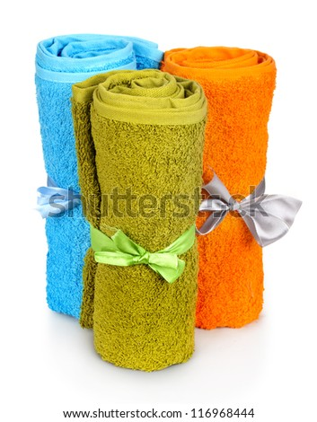 towel rolled with ribbon on a white background - stock photo