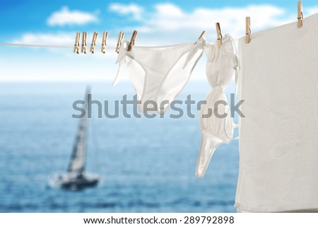 towel swimsuit and boat on sea