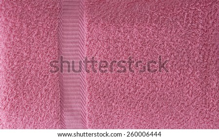 Towel Texture. Top View of a Red Plush Terry Surface. Soft Towel Textile Background. Text Space - stock photo