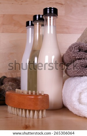 Towels and bottles in spa setting - stock photo