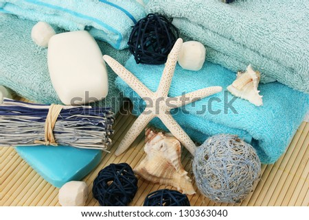 Towels and decoration on bamboo mat. - stock photo