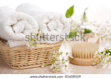 towels flowers and massage brush - stock photo