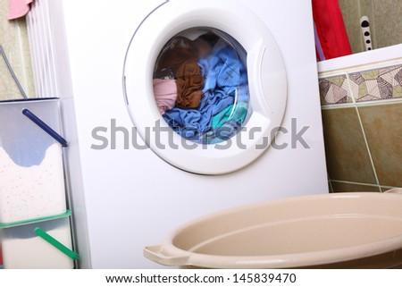 towels in washing machine cloths indoor bathroom - stock photo