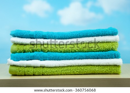 Towels on a blue sky background. - stock photo