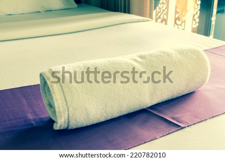 towels on the bed - stock photo