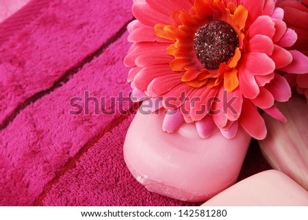 Towels, soaps and flowers closeup picture. - stock photo