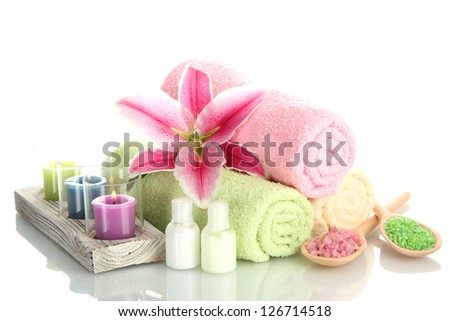 towels with lily, aroma oil,  candles and sea salt isolated on white - stock photo