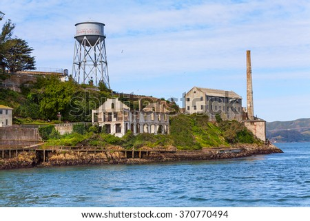 Tower and administrative buildings ruins Alcatraz - stock photo