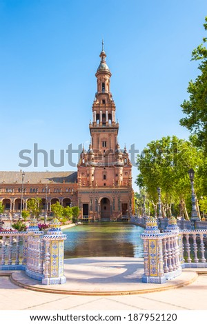 Tower and river of the Central building at the Plaza de Espana in Seville, Andalusia, Spain. It's example of the Renaissance Revival style in Spanish architecture. - stock photo