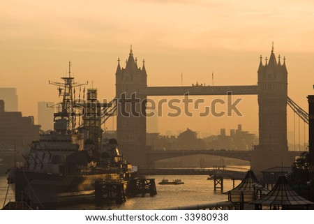 tower bridge and hms belfast at dawn. This photo truly expresses the beauty of the iconic london landmarks at sunrise - stock photo