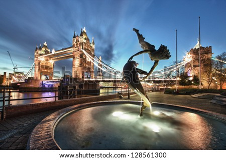 Tower Bridge and St Katharine Docks 'Girl with a dolpin' fountain - stock photo