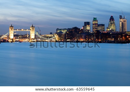 Tower bridge and the city of London - stock photo