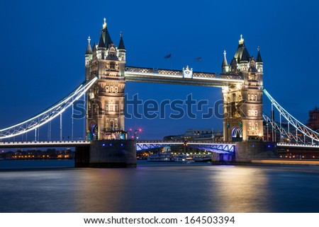Tower Bridge at night, River Thames, London, UK - stock photo