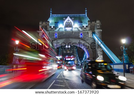 Tower Bridge Buses and a Taxi - stock photo