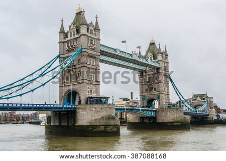 Tower Bridge (1886-1894) - iconic symbol of London. It is a combined bascule and suspension bridge in London, over River Thames. Tower Bridge is close to Tower of London, from which it takes its name.