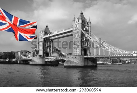 Tower Bridge in London and flag - black and white photo - stock photo