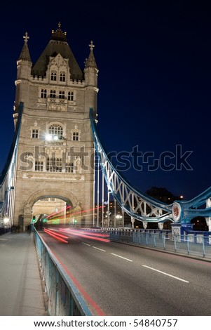 Tower Bridge in London by night - stock photo