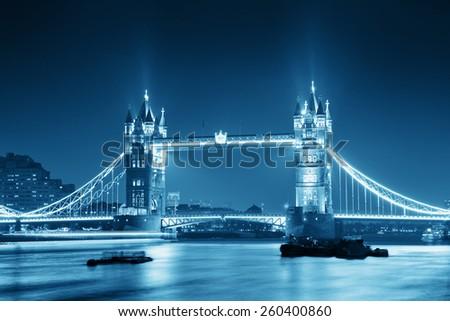 Tower Bridge in London in blue tone at night. - stock photo
