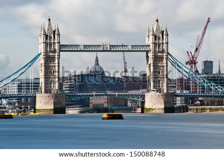Tower Bridge in London. The long exposure creates a beautiful effect on the waters of the river Thames and the clouds passing over the city.
