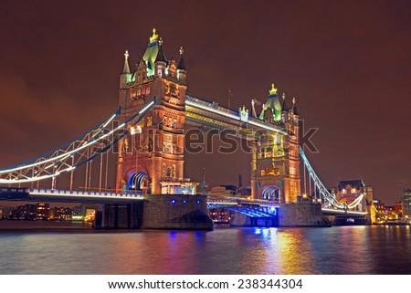 Tower bridge in London UK by night - stock photo