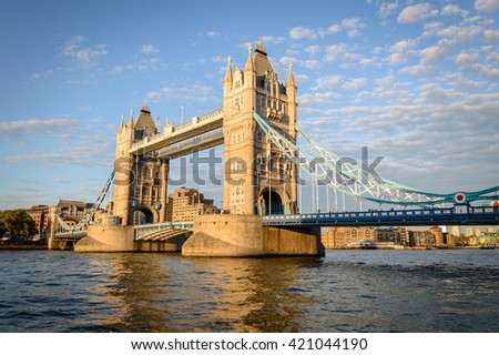 Tower Bridge in London, UK. Tower Bridge is a combined bascule and suspension bridge in London. The bridge crosses the River Thames close to Tower of London and has become an iconic symbol of London - stock photo