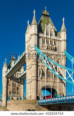 Tower bridge in London with a red bus - stock photo