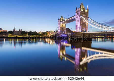 Tower Bridge in the evening with reflection in London, UK.