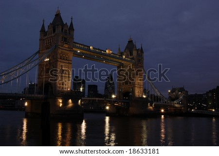 Tower bridge lit up at night from the South Bank, London, England
