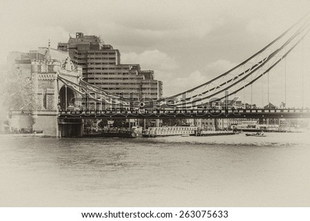 Tower Bridge over River Thames - iconic symbol of London. It is a combined bascule and suspension bridge. Tower Bridge is close to Tower of London, from which it takes its name. Antique vintage.