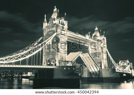 Tower Bridge over Thames River at night in London - stock photo
