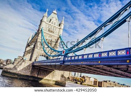 Tower Bridge over the Thames River, London, UK. - stock photo