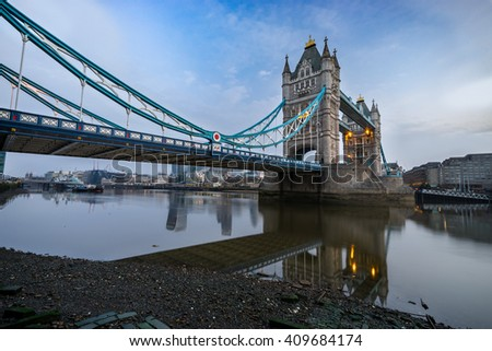 Tower Bridge viewed in the morning at low tide in London, England