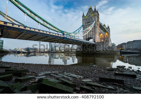 Tower Bridge viewed in the morning during low tide in London, England - stock photo