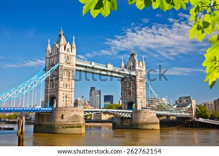 Tower bridge with green leaves, London - stock photo
