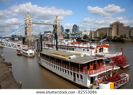 Tower Bridge with steam boats in London, UK - stock photo
