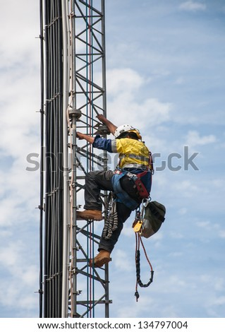 Tower climber the guyed tower cellular system. - stock photo