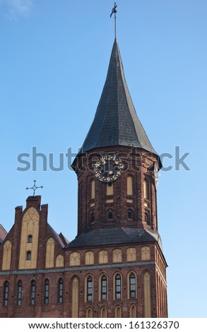Tower clock of Cathedral of Immanuel Kant in Kaliningrad, Russia - stock photo