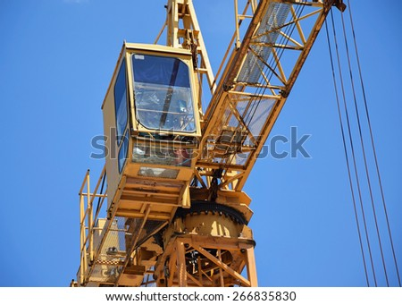Tower crane at the construction site - stock photo