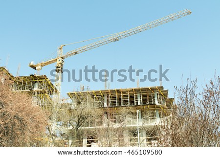 tower crane builds the house, nature