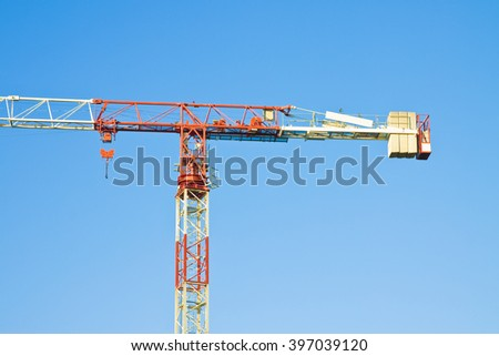 Tower crane in a blue background